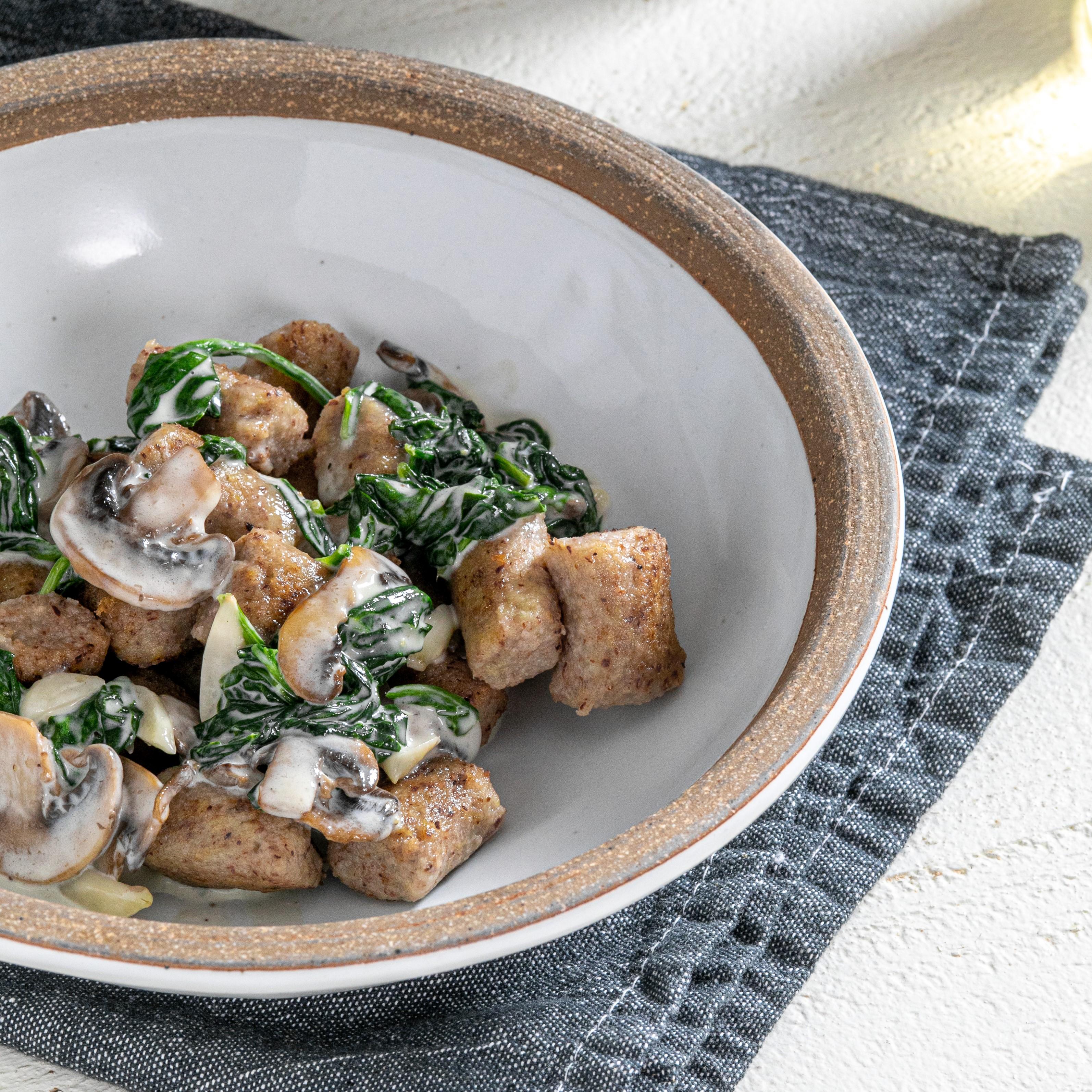 Gluten-free Pecan Gnocchi with Mushroom Cream Sauce