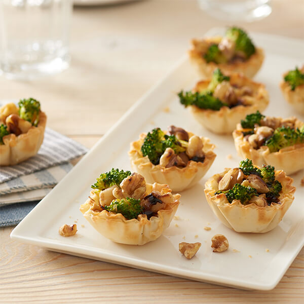 Mini Broccoli and Cheddar Quiches with Walnut Topping
